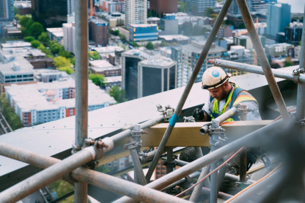 Picture of a construction worker working on steel frames